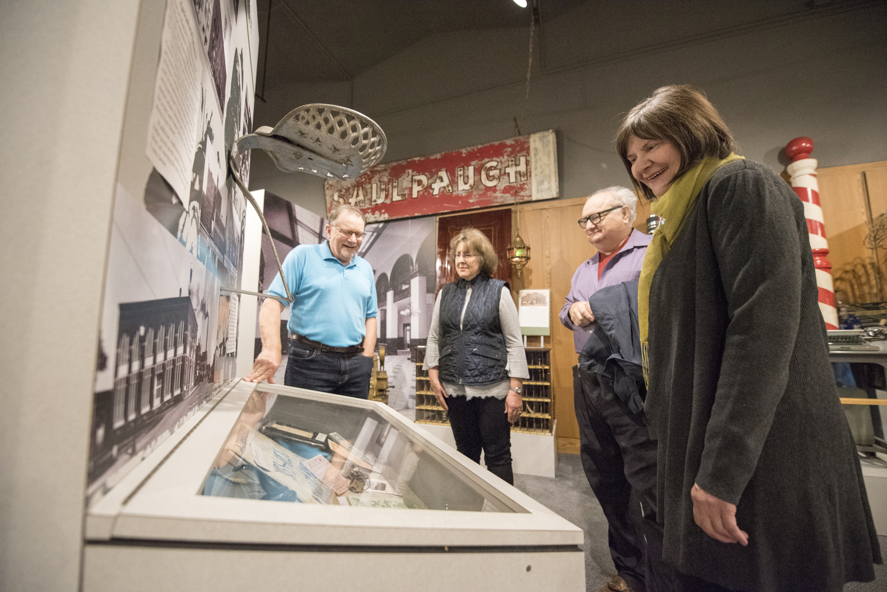 People standing in the museum looking at a display