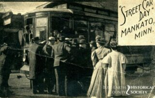 Streetcar with people standing outside of it
