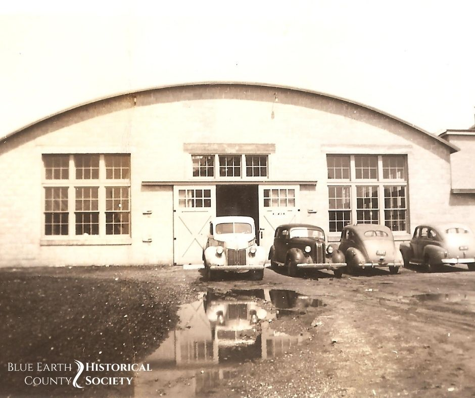 Exterior of the Mapleton Hemp Plant in the 1930s with cars in front of the building.