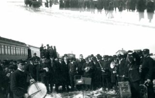 Railroad History, people gathered around the train in 1868