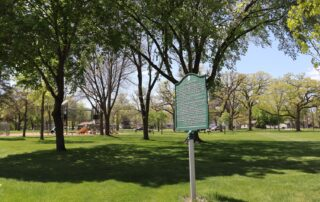 Modern picture of Highland Park showing Heritage Plaque and playset.