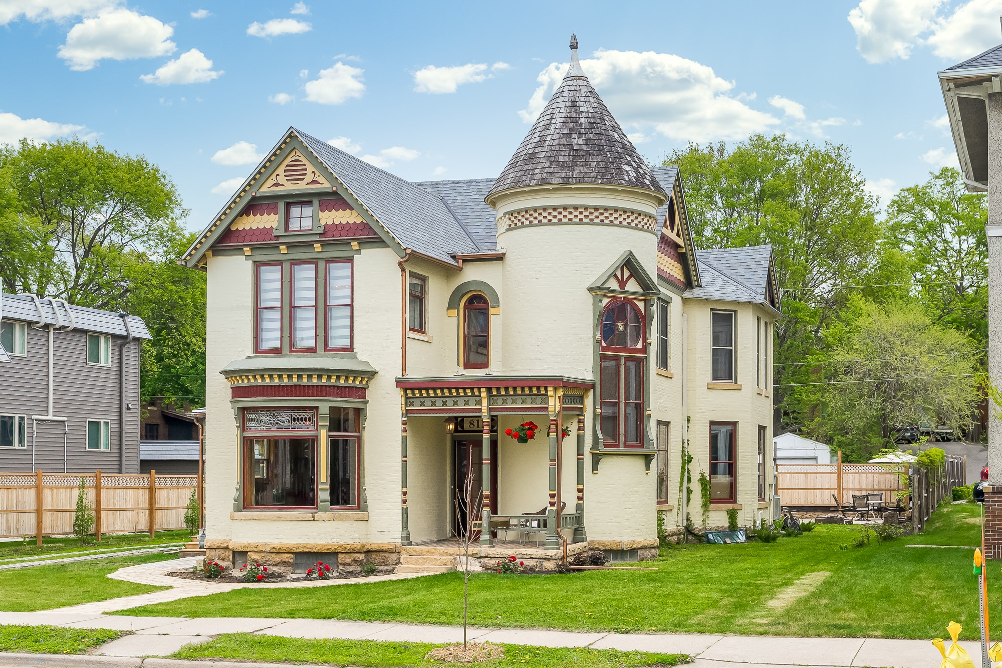 Moulin Rouge House now after a complete restoration project! Cream colored house with tower.