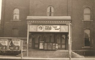Formerly Harmonia Hall, shown here The Orpheum, c 1924. Sepia toned image of a building.