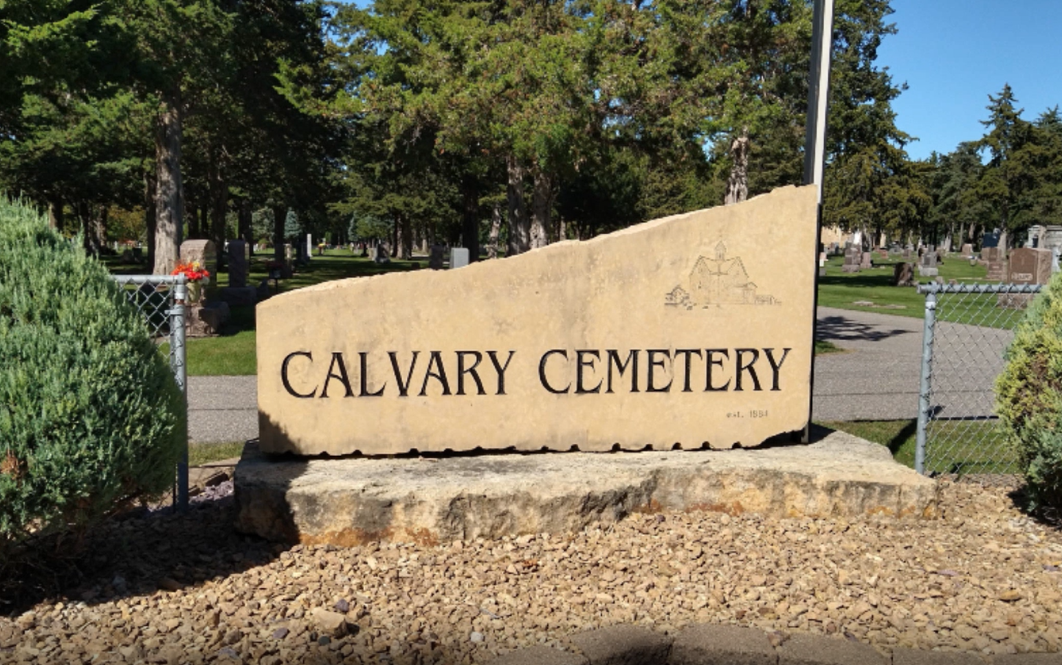 Image of the Calvary Cemetery entrance monument. Color image c. 2020