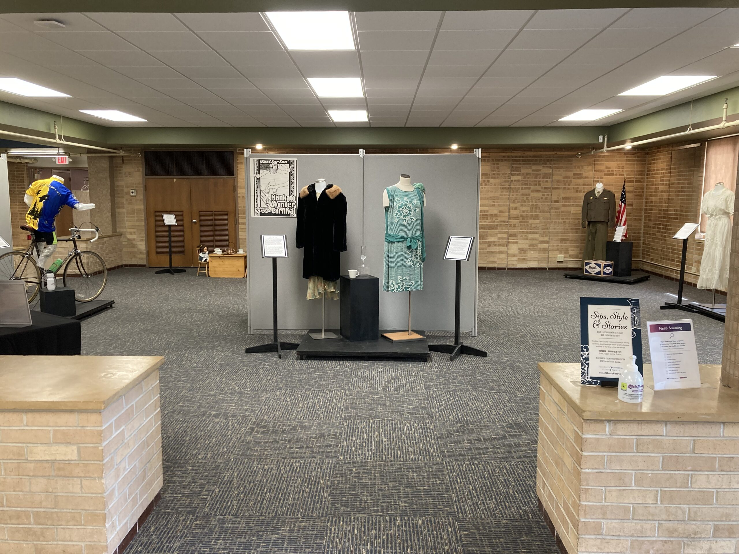Head-on view of the Sips, Styles and Stories exhibit on display at the History Center through December 31, 2021