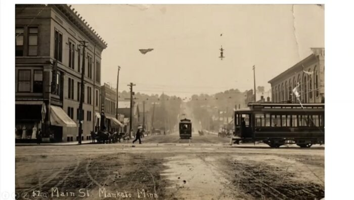 Two electric street cars on Mankato's Main Street